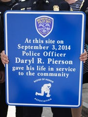 A sign in honor of Officer Daryl Pierson will be unveiled at the corner of Hudson Avenue and Ernst Street.