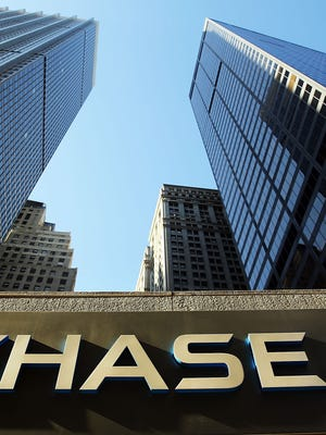 This 2014 photo taken in New York City shows bank sign at One Chase Plaza in lower Manhattan.