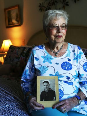 Marcelle Reiss, 91, holds a photo of her late ex husband Harvey Fox in her home at The Carlisle Naples on Wednesday, Sept. 28, 2016. Fox served in the United States Navy during the Pearl Harbor attacks.
