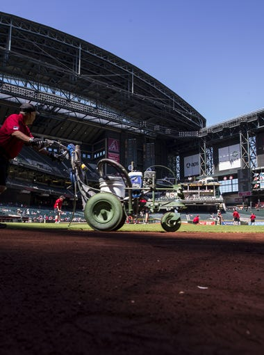 Field maintenance workers prepare the field before the Diamondbacks' last spring training game against the Indians on Tuesday, Mar. 27, 2018 at Chase Field in Phoenix.