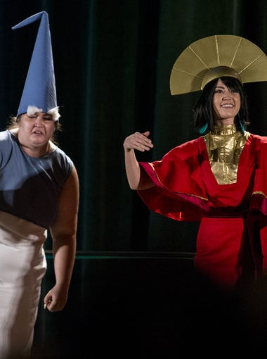 Prue Dense, left, dressed as The Old Man, and Elizabeth Todd, dressed as Kuzco, perform in the masquerade during Day four of Phoenix Comic Fest on Sunday, May 27, 2018 at Phoenix Convention Center in Phoenix.