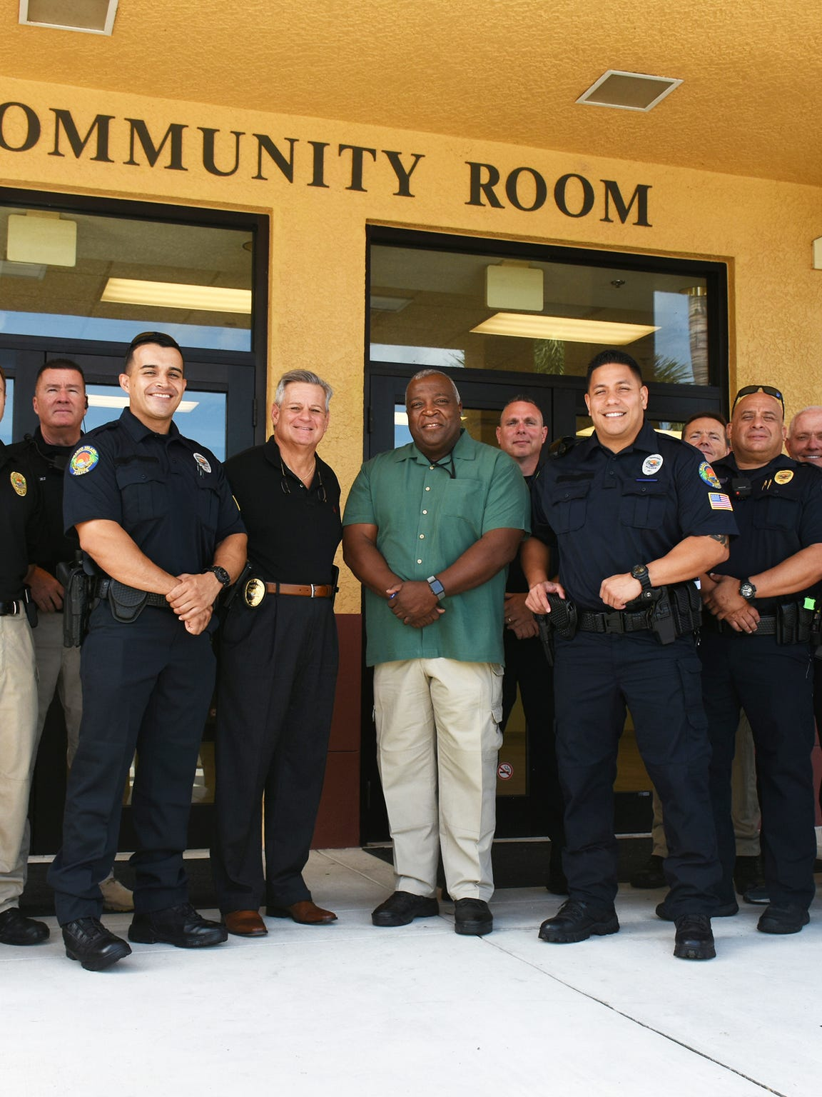 Police officers pose outside the Marco Island Police Department last year. At the time, there were no female officers part of the department.