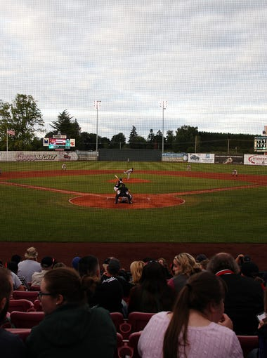 Fans watch their team during the Salem-Keizer Volcanoes season opener as they faced the Tri-City Dust Devils at Volcanoes Field in Keizer Friday night, June 15, 2018. The Volcanoes went on to win their game. (KELLY JORDAN / Statesman Journal)