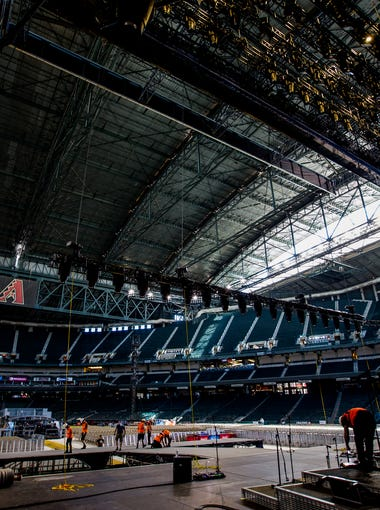Crews set up for Kenny Chesney's Trip Around the Sun Tour concert on June 22, 2018, at Chase Field in Phoenix.