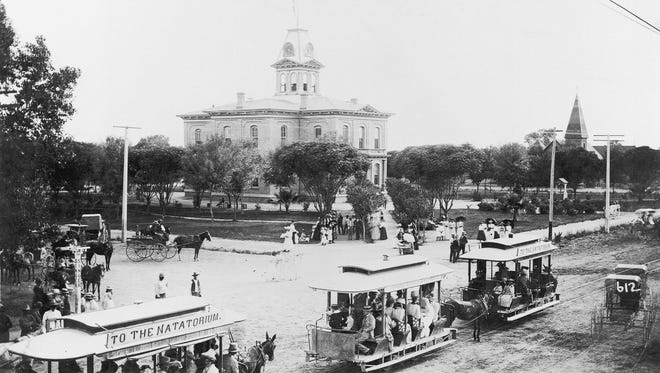 Horse-drawn streetcars pass by the old courthouse at Eastlake Park in Phoenix in the late 1890s.