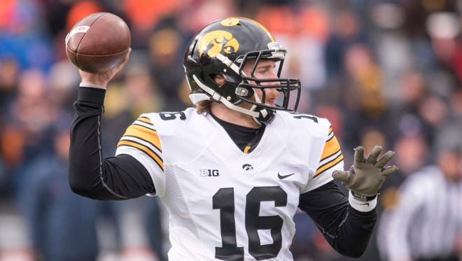 Iowa quarterback C.J. Beathard (16) throws a pass during the first quarter of an NCAA college football game against Illinois, Saturday, Nov. 19, 2016, at Memorial Stadium in Champaign, Ill.