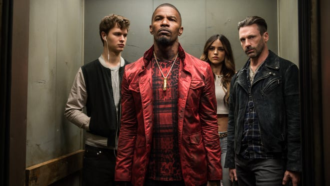 "Baby (Ansel Elgort), Bats (Jamie Foxx), Darling (Eiza Gonzalez) and Buddy (Jon Hamm) decide on doing the heist in ""Baby Driver."""