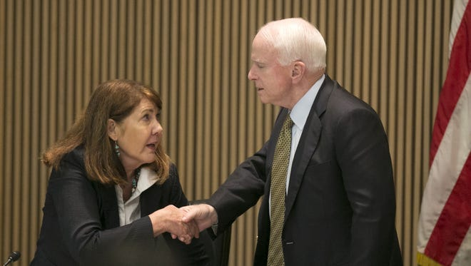 U.S. Rep. Ann Kirkpatrick, D-Ariz., and  U.S. Sen. John McCain, R-Ariz., shake hands following a congressional hearing looking into the Gold King Mine Spill in Colorado from August of 2015, at Phoenix City Hall on Friday, April 22, 2016. The U.S. Senate candidates have agreed to their first, and likely only, debate of the 2016 election, in an event sponsored by The Arizona Republic and Arizona PBS.