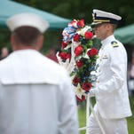 U.S. Coast Guard Commander (for the Ohio Valley Section) Eric Denley processes with the honor wreath to the Patriots Peace Memorial. 25 May 2015