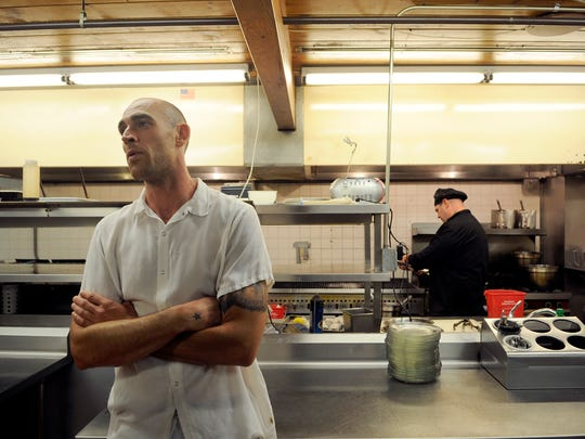 Daniel Dean, head chef of Nick's Third Floor at D.B. Searle's, talks about his career at the restaurant Thursday. Dean has worked at 27 different restaurants in the California and Washington area. Nick's Third Floor uses locally grown produce for its special dishes.