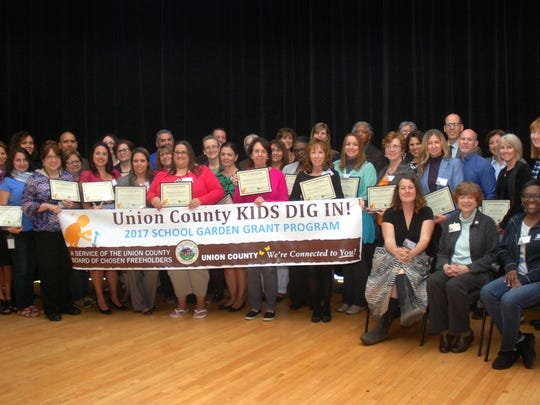 Union County Kids Dig In! grants were recently presented by Union County Freeholder Vice Chairman Sergio Granados and Freeholders Bette Jane Kowalski and Angel G. Estrada to representatives from 32 schools in 12 county municipalities during a ceremony at the Hamilton Stage in Rahway.