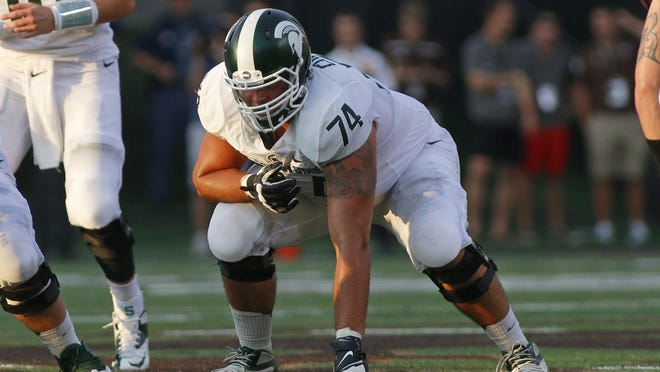 Michigan State offensive lineman Jack Conklin (74) prepares to block against Western Michigan during the first quarter of an NCAA college football game, Friday, Sept. 4, 2015, in Kalamazoo, Mich. Michigan State won 37-24. (AP Photo/Al Goldis)