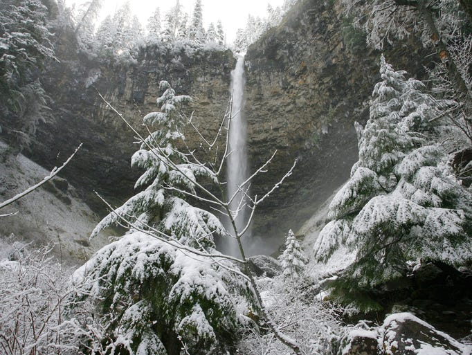 Watson Falls drops into the snow. The 272 foot falls is located off Highway 138 in the North Umpqua River area.