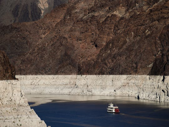 In this Oct. 14, 2015, photo, a riverboat glides through Lake Mead on the Colorado River at Hoover Dam near Boulder City, Nev. Amid an historic drought in the West, federal water managers are due to release an annual projection of surface levels at Lake Mead that'll determine whether water deliveries from the crucial Colorado River reservoir will be cut next year to Arizona, Nevada and California.