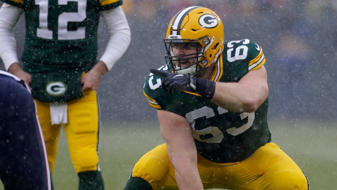 Packers center Corey Linsley makes an adjustment at the line during the first quarter of a game against the Houston Texans on Dec. 4 at Lambeau Field in Green Bay.