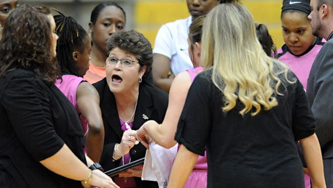 Southern Miss head coach Joye Lee-McNelis talks to her players during a game against Charlotte at Reed Green Coliseum.