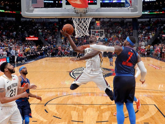 New Orleans Pelicans center Emeka Okafor goes to the basket against Oklahoma City Thunder forward Carmelo Anthony (7) during the first half of an NBA basketball game in New Orleans, Sunday, April 1, 2018. (AP Photo/Gerald Herbert)