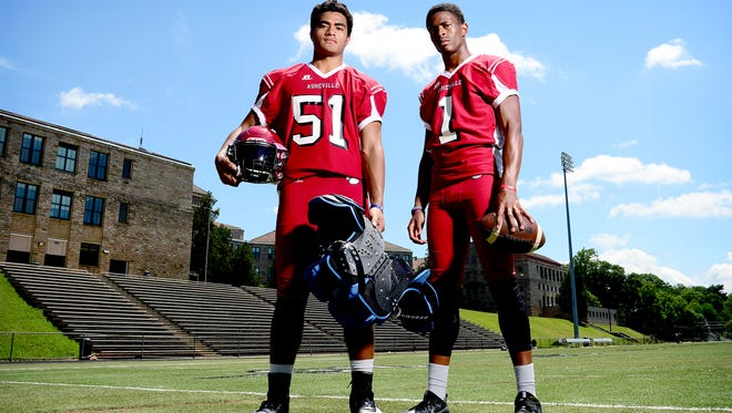 Asheville High football players Andrew Leota, left, and Makaius Brewer.