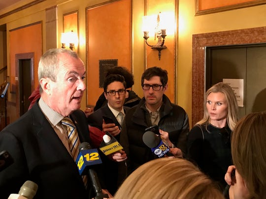 Gov.-elect Phil Murphy speaks to reporters after brief remarks at a meeting of one of his transition committees at the Trenton War Memorial on Nov. 28, 2017.