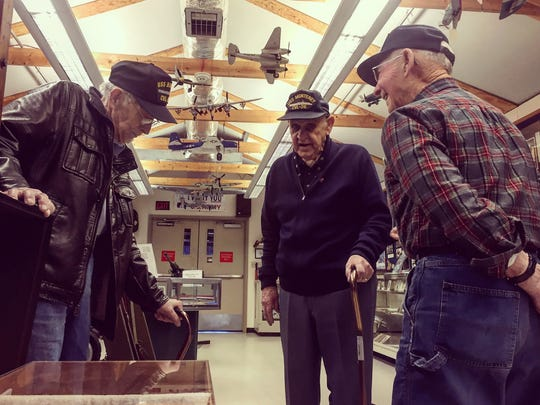World War II Navy veterans (from left) Ed Turner, Owen Garrison and Jack Williams trade stories Friday at the Millville Army Air Field Museum.