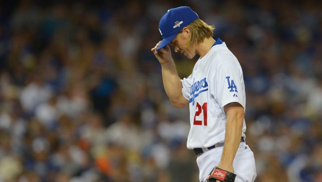 Oct 10, 2015: Los Angeles Dodgers starting pitcher Zack Greinke (21) reacts during the sixth inning in game two of the NLDS against the New York Mets at Dodger Stadium.