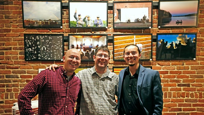 Springfield News-Leader staff photographers (from left) Nathan Papes, Andrew Jansen and Guillermo Hernandez Martinez pose for a photograph at the News-Leader's Best of Photos 2015 photo show and auction held at The Coffee Ethic in Springfield, Mo. on Feb. 5, 2016.