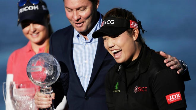 Ariya Jutanugarn  celebrates winning the Race to the CME Globe and Rolex Player of the Year during the award ceremony after the CME Group Tour Championship at Tiburon Golf Club.