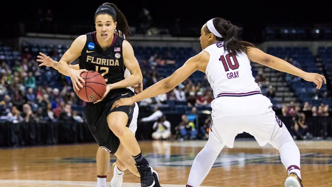 Florida State guard Brittany Brown (12) dribbles past South Carolina guard Allisha Gray (10) during the Seminoles 71-64 defeat in the Elite Eight of the women's 2017 NCAA Tournament at Stockton Arena.