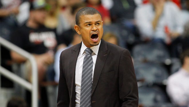 Mar 28, 2017; Atlanta, GA, USA; Phoenix Suns head coach Earl Watson yells from the sidelines against the Atlanta Hawks in the first quarter at Philips Arena.