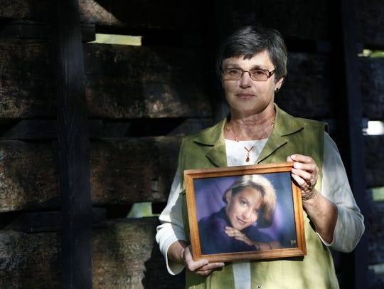 Mary Wegner holds a photograph of her daughter Laurie Depies at her Winneconne, Wis., home in October 2011. Convicted child kidnapper Larry DeWayne Hall confessed recently to killing Laurie Depies in 1993 and Wegner is still waiting to find out if Hall is indeed the killer.