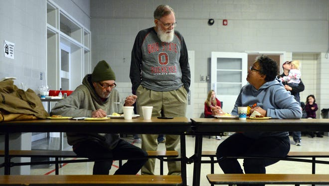 Connexion West volunteers Penny Barbour, right, Ivan Smith, center, and a warming center client identified only as Dave, talk during lunch Tuesday, Jan. 2, 2018, in Lancaster. As temperatures hover in the single digits Connexion West has opened a warming center.