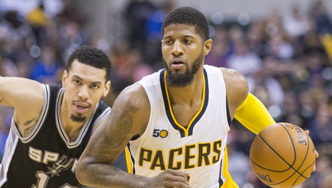 Paul George of Indiana, is defended by Danny Green, San Antonio Spurs at Indiana Pacers, Bankers Life Fieldhouse, Indianapolis, Monday, February 13, 2017. San Antonio won 110-106.