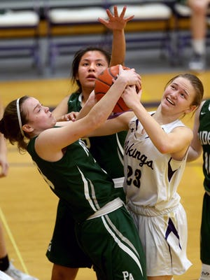 North Kitsap girls basketball player Raelee Moore, right, gets tied up with Port Angeles player Jaida Wood for a rebound Tuesday night at North Kitsap.