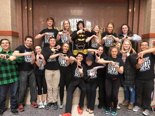 Wausau East DECA chapter members pose for a picture.