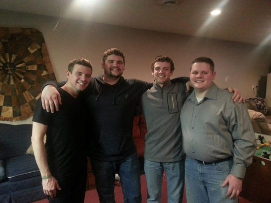 The Sutton sons -- Anthony, 27; Ryan, 25; and 23-year-old