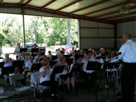 America's Hometown Band members performing at Band
