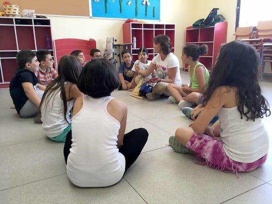 Students in Amman, Jordan, participate in a Take Note