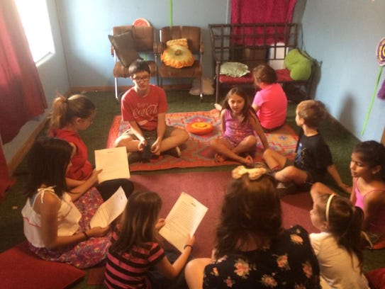 Young Art of Love actors gather for a group reading.