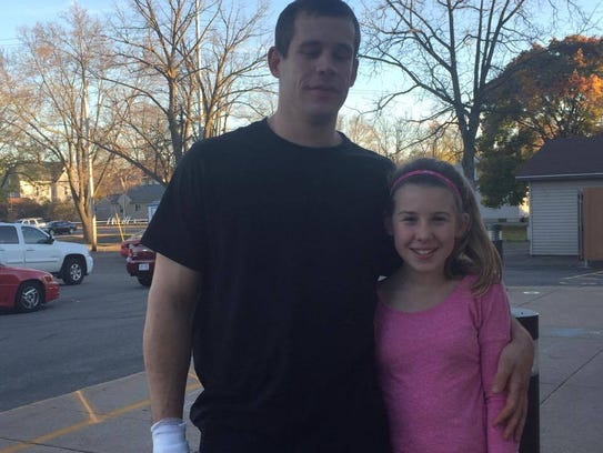 Mark Nelson, shown with his daughter, burned himself