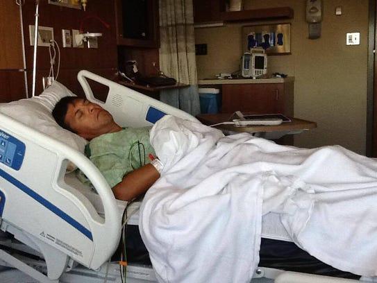 Alex Solis rests after receiving his kidney transplant