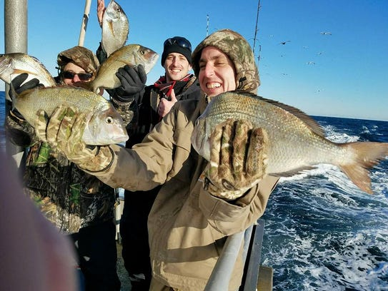Anglers with a catch of porgies on the 125-foot Jamaica