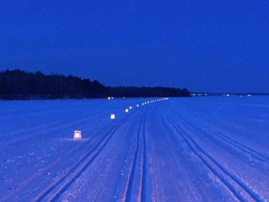 Hundreds of ice luminaries mark the Book Across the