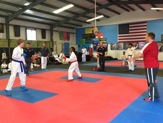 After training on techniques, participants spar at