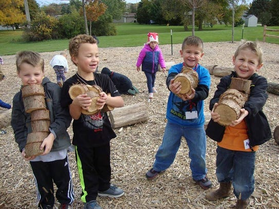 File - Boys with tree cookies at the Riverview Kindergarten