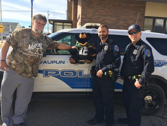 Dennis Schulze, left, poses with Waupun Police Officers