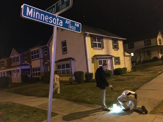 Investigators collect evidence in Lonsdale after a