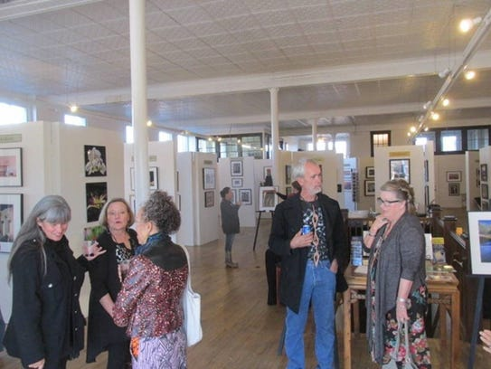 Guests poured into the Tularosa Basin Gallery of Photography's