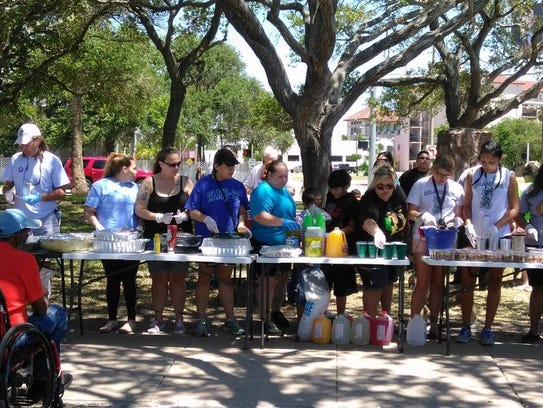 Tacos Not Bombs members serve food May 7, 2017, at