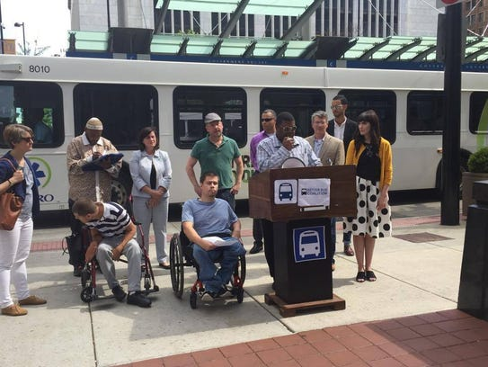 Cam Hardy speaks at the Better Bus Coalition's press