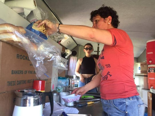 Terri Albrecht, 52, makes nachos for a customer at last year's Stormville Airport Food Truck and Craft Beer Festival.